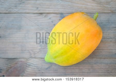Yellow papaya organic on a wooden floor.