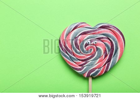 Sweet Lollipop With Googly Eyes On Green Background