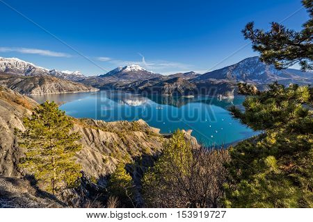Serre Poncon Lake from Le Rousset with Winter view on Saint Vincent Les Fort and Le Sauze du Lac. A peaceful area in Hautes Alpes, the Southern French Alps. France