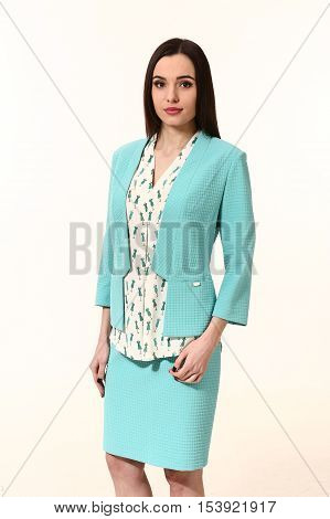 arabian business executive woman with straight hair style in official two pieces skirt jacket power suit close up portrait isolated on white
