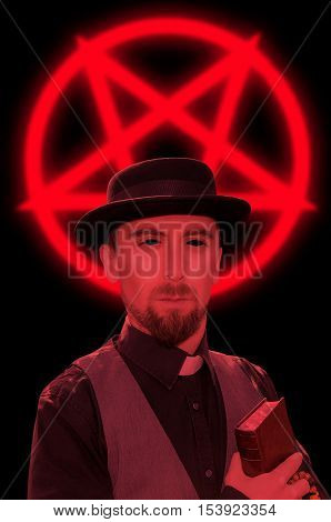 Satanic priest with book on red pentagram background