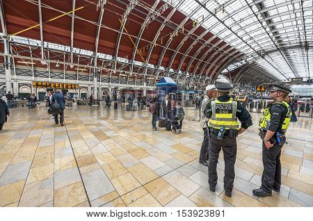 London, the UK - May 2016: policemen on duty at Paddington railway station