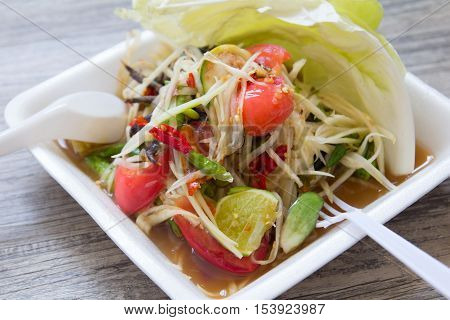 Thai vegetable salad (Som tum) on foam plate