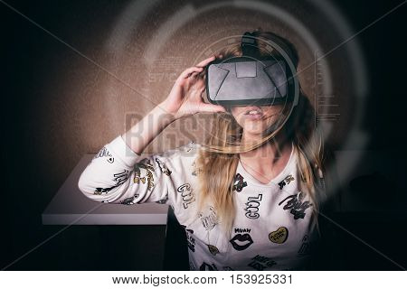 blonde girl playing and enjoy in virtual reality