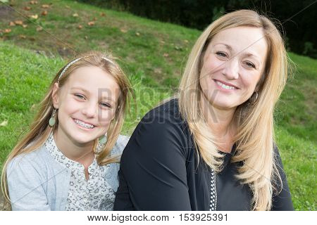 Mom And Daughter In Happines At The Outside In The Meadow