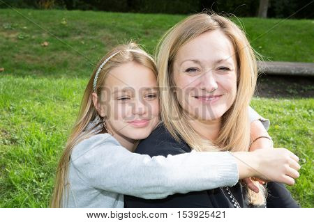 Happy Mother And Daughter In Happines At The Outside