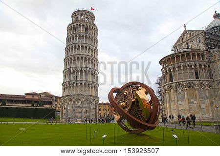 PISA, ITALY - JANUARY 9, 2016: Leaning tower of Pisa and modern sculpture on Square of Miracles in Pisa, Italy.
