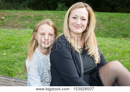 Mother and daughter in happines at outside in the meadow
