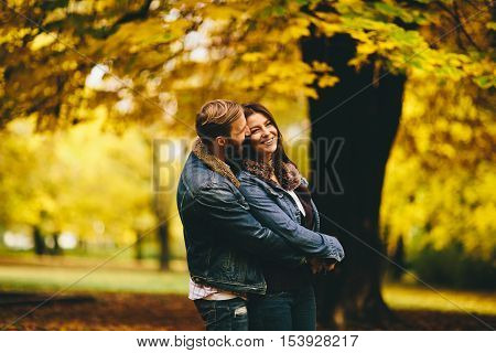 Loving Couple In Autumn Park