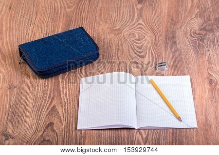School supplies on the wooden background .