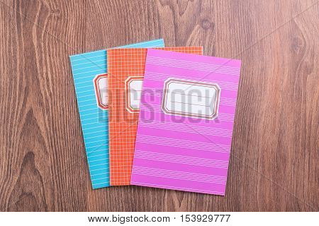 Colored Exercise Books On The Blue Wooden Background