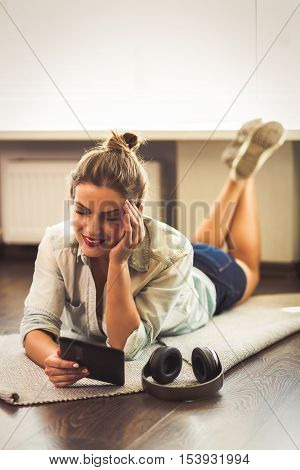 Pretty Young Woman Reading An E-book