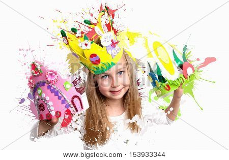 Little girl demonstrating her craft work, Easter bonnets and crown.