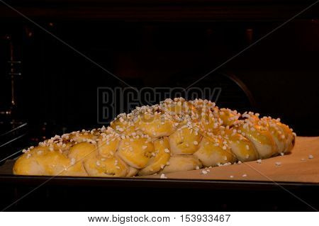 Braided brioche made from pastry in the oven