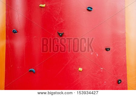 Red climbing wall. Adrenaline sport theme. Leisure activity.