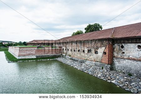 Old castle with moat in Holic Slovak republic. Cultural heritage. Architectural theme. Historical object.