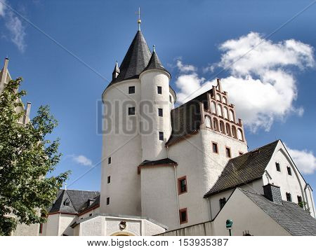 Partial view and keep of Schwarzenberg Castle in Erzgebirge in Saxony, Germany; sunny day with blue sky