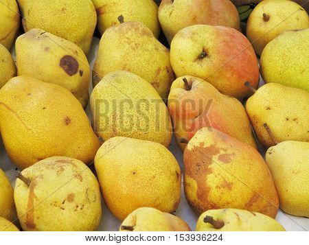 Ripe Yellow Pears Stacked In A Box Texture Background