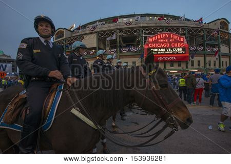 CHICAGO/OCTOBER 2016 Chicago mounted police watch fans gather in front of Wrigley Field marquee for historic beginning to World Series 2016