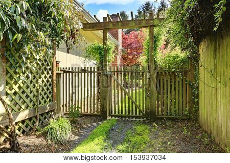 Gateway To The Back Yard. Rustic Wooden Gate And Fence