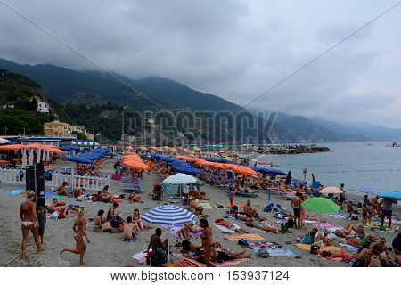 Monterosso Italy - September 4 2016: Unidentified people on beach in Monterosso in Liguria Italy. One of five Cinque Terre cities (unesco world heritage)