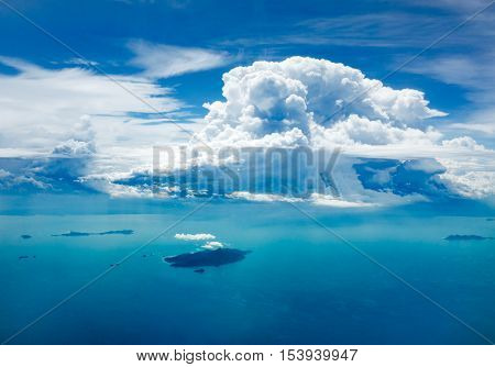 Cloud and ocean with island shot from aerial view