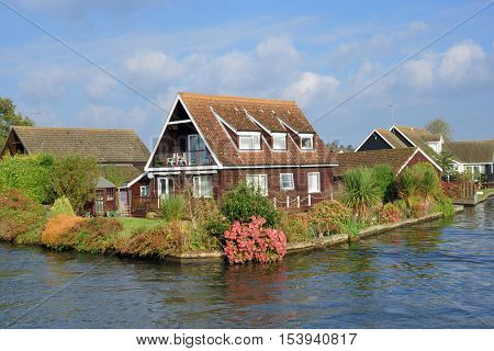 Large UK riverside house with large river at front