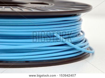 Blue coloured 3d printing filament plastic spool