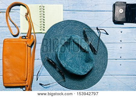 Set of modern girl: female accessories on the blue planked surface. Flat lay. Color toning
