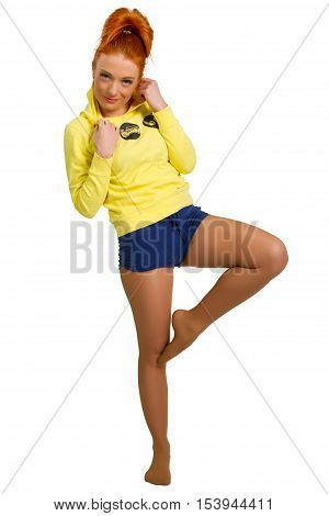 red-haired girl in a yellow jacket isolated on white background