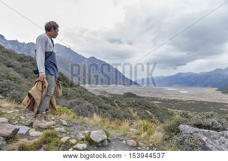 A Man Looking At The Tasman River From Viewpoint Along The Walking Trail To The Blue Lakes And Tasma