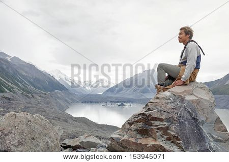 A Man At Tasman Glacier Viewpoint Where New Zealand's Longest Glacier Begins And The Lower Reaches W