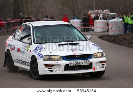 Moscow Russia - Apr 18 2015: Subaru Impreza driver Michulit Andrey and co-driver Vinogradova Lidia during the Rally Masters Show 2015 at the Krylatskoye District.
