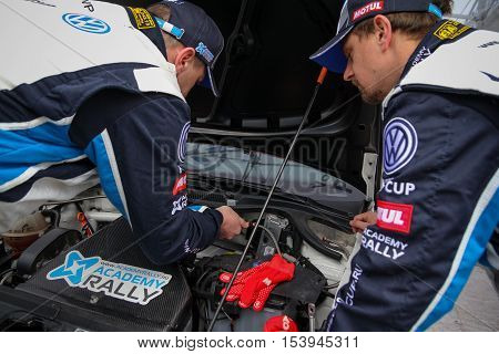 Moscow Russia - Apr 18 2015: Unidentified drivers work under the VW Polo hood during the Rally Masters Show 2015.