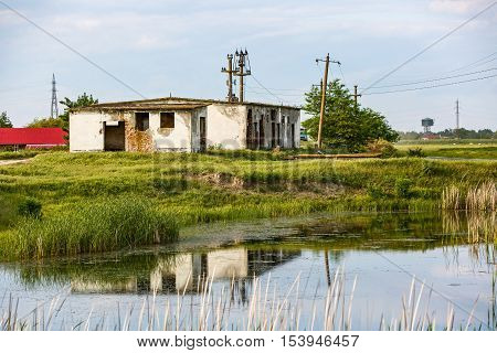Photo of abandoned building near to lake