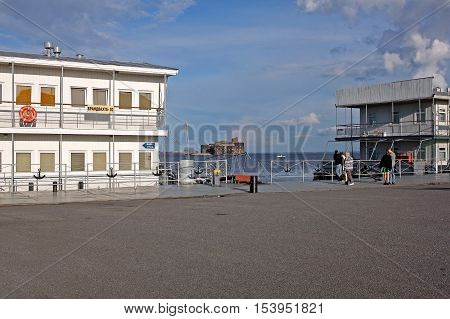 Kronstadt Russia - July 10 2016: view of the Fort Alexander (plague Fort) and a pier near Fort Constantine. The FORTS of Saint-Petersburg is a complex of permanent fortifications at different times built to protect the capital from attack from the sea.