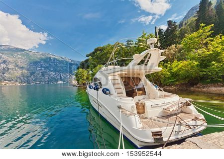 speedboat near the pier on mountains background. Montenegro
