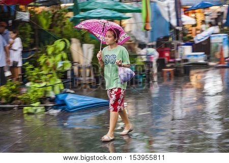 People In Blurred Motion At  At  Chatuchak  Weekend Market In Rain