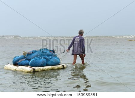 The Unidentified Old Man Walking And Bring The Trawl