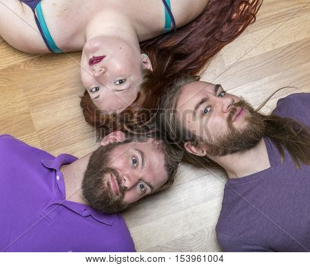 Millennial Woman with Two Men illustrative of a romantic triangle or polyamory and of modern romance or friendship. poster