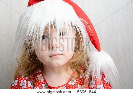 Portrait Of A Little Girl In Santa Hat