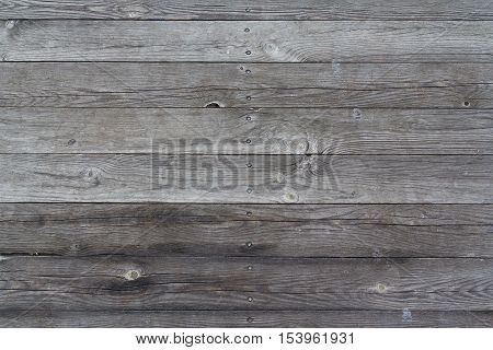 Old cracked board fence. Backgrounds and textures