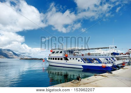 Small Ferryboat Docked In Greek Town