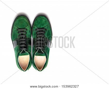 Green male shoes on a white background