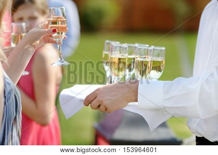 Waiter With Dish Of Champagne Glasses