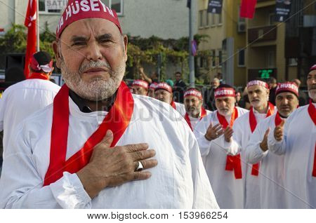 Istanbul Turkey - October 11 2016: Turkish Shia men take part in commemorations marking the mourning period of Ashura. The participants in the memorial services wear the names of martyrs on bands around their foreheads. T