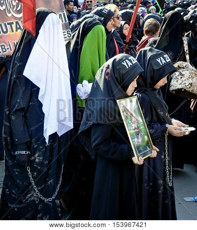 Istanbul Turkey - October 11 2016: Turkish Shia women takes part in an Ashura parade in Istanbul's district of Kucukcekmece. Turkish Shia Muslims mourning for Imam Hussain.