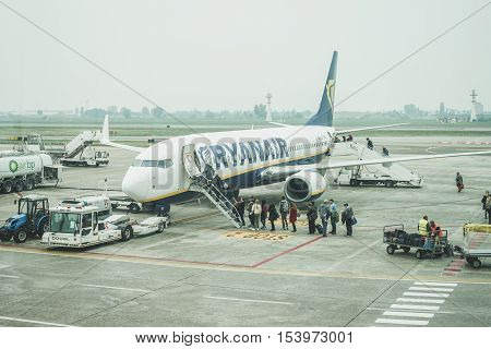 BOLOGNA AIRPORT MARCONI ITALY - OCTOBER 13 2016: Ryanair Airlines plane take people inn from Bologna airport.