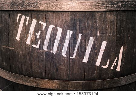 Wooden barrel with iron rings with the word