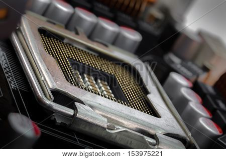 empty CPU socket between the capacitors and coils in the supply part on PCB motherboard